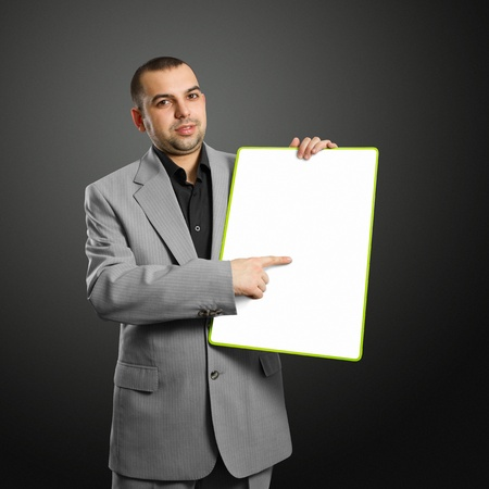 adult  body writing: happy businesswoman holding blank white card in her hands
