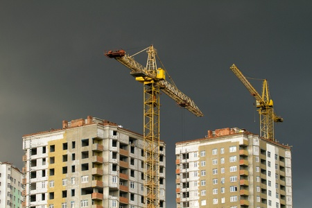 background with development and crane, against sky photo
