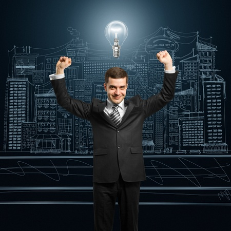 hooray: excited lamp-head businessman with hands up  Stock Photo