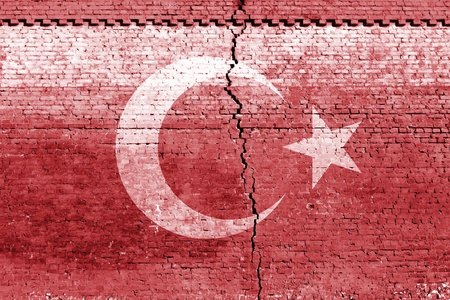 cracked brick wall as Turkey flag, symbolize the recent earthquake photo