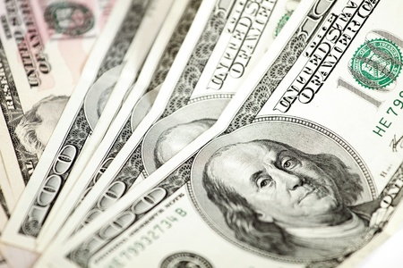 abstract dollars background against white photo