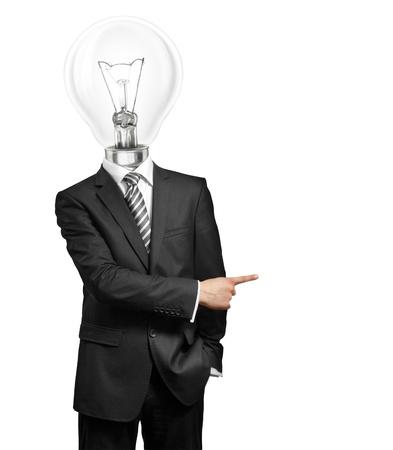ランプ ヘッド ビジネスマンが何かに彼の指でアイデアと表示を持っています。