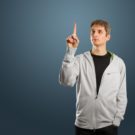 man pushs the button on virtual touch pad Stock Photo - 11394032