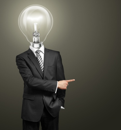 lamp head businessman have got an idea and showing with his finger to something Фото со стока - 11713755