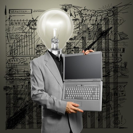 Idea concept, man lamp head businessman with laptop in his hands Stock Photo - 11835516