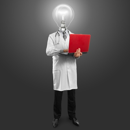 Idea concept, doctor man with lamp head, with laptop in his hands photo