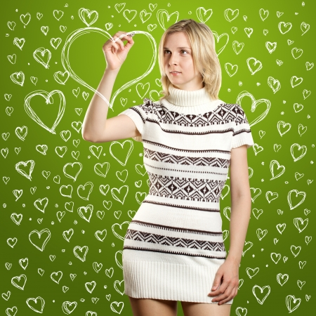 woman drawing heart shapes on valentine day photo