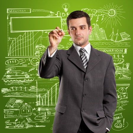 Idea concept, man businessman writing something on glass board with marker photo