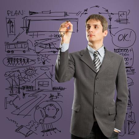 男性のマーカーとガラス基板上に何かを書く 写真素材
