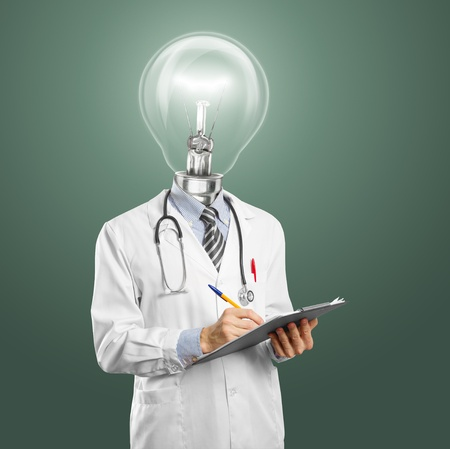 lamphead doctor writing something on clipboard Stock Photo - 12251535