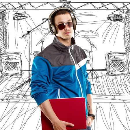 Man with headphones and laptop, listening to the music photo