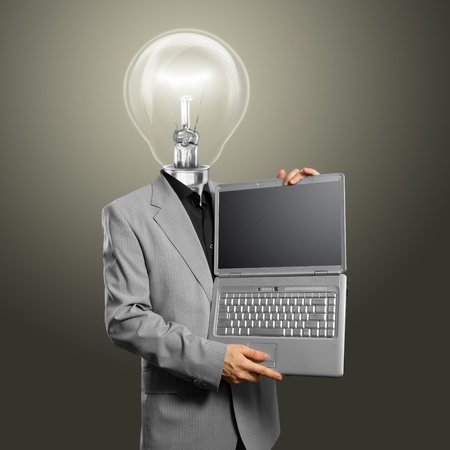 Idea concept, man lamp head businessman with laptop in his hands Stock Photo - 12251553