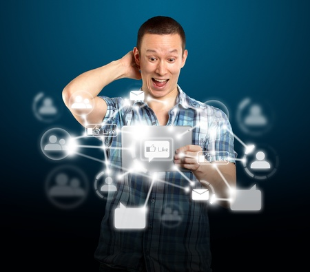 Social network concept, man with i pad in his hands Редакционное