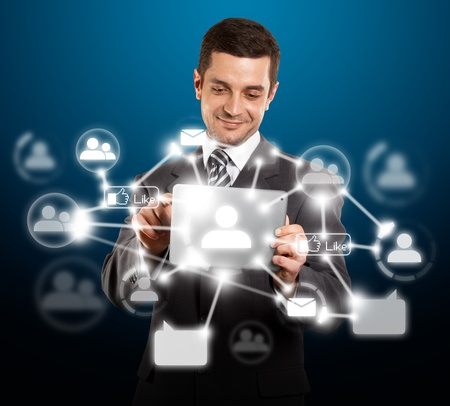 Social network concept, businessman with i pad in his hands Stock Photo - 12547503