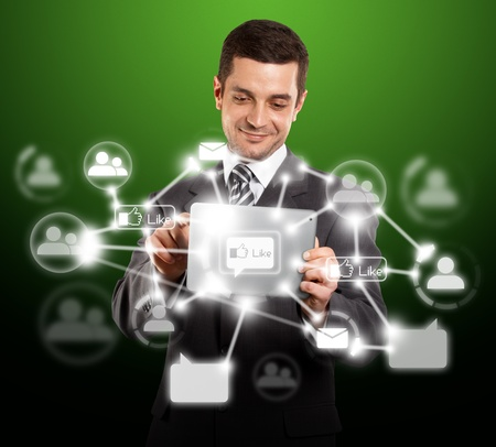 i pad: Social network concept, businessman with i pad in his hands