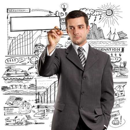 Idea concept, man businessman writing something on glass board with marker Stock Photo - 12547529