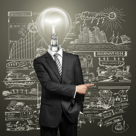 idea light bulb: lamp head businessman have got an idea and showing with his finger to something
