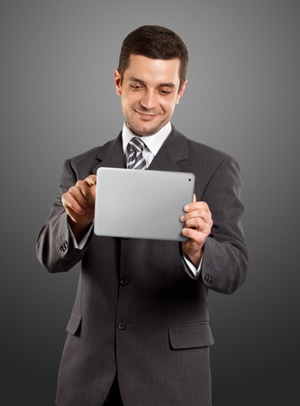 i pad: man businessman in suit with i pad in his hands
