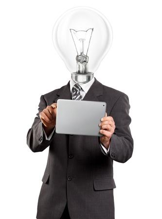 pensamiento creativo: Concepto de Idea, el empresario l�mpara de cabeza en el juego con el teclado t�ctil en sus manos