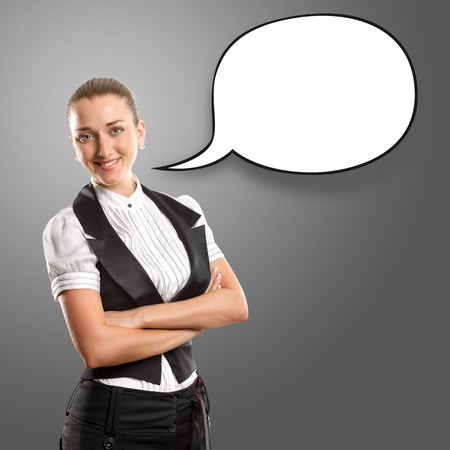 Business woman with speech bubble, looking on camera photo