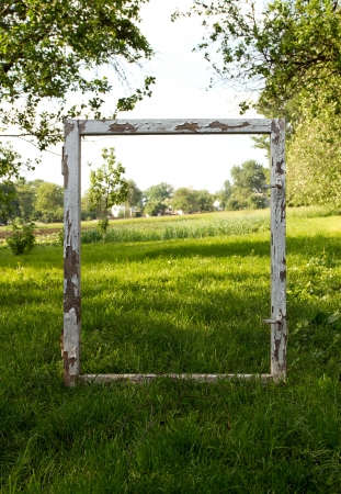 Window frame concept, frame lying on the grass outdoors photo