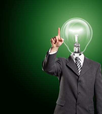Lamp head business man push the button on virtual touch pad Stock Photo - 14114401