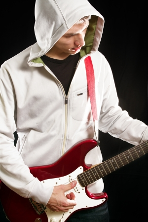 Man with red elegtric guitar, playing solo photo