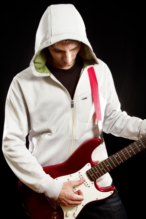 stratocaster: Man with red elegtric guitar, playing solo Stock Photo