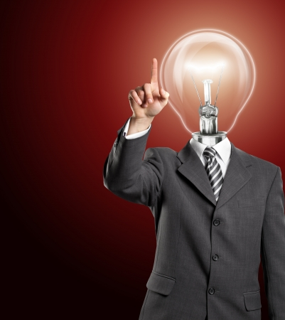 Lamp head business man push the button on virtual touch pad Stock Photo - 14523780