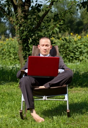 Man Businessman working outdoors, as freelanser and have fun photo