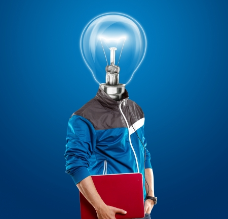 power of thinking: Lamp Head man with laptop, listening to the music