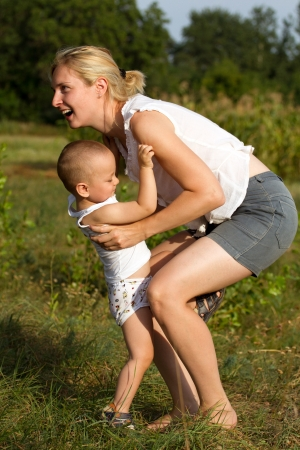 Family, mother and son playing and have fun outdoors photo