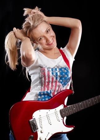 fender stratocaster: Woman playing the electrical guitar and have fun