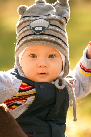 spring hat: Baby outdoors close to nature and have fun Stock Photo