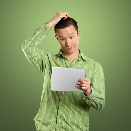 joy pad: Business man in suit with touch pad in his hands