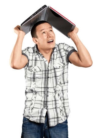 Asian man hides under the laptop in his hands photo