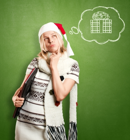 Woman with Santa's hat waiting for Christmas, with laptop in her hands photo