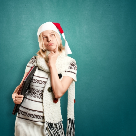 Woman with Santas hat waiting for Christmas, with laptop in her hands photo