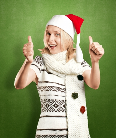 Woman with Santas hat waiting for Christmas photo