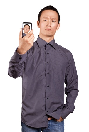Asian man making an avatar on cell phone in social network Stock Photo - 16718306