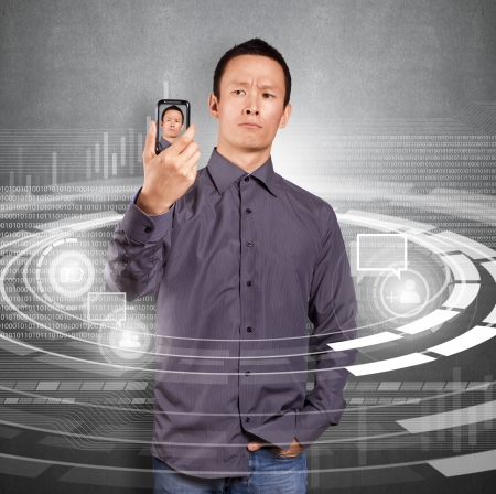 Asian man making an avatar on cell phone in social network Stock Photo - 16718961