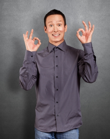 Asian man shows OK with both hands Stock Photo - 16718502