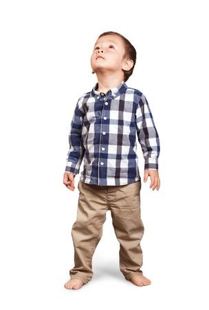 スタジオにかわいい男の子を捜している赤ん坊 写真素材