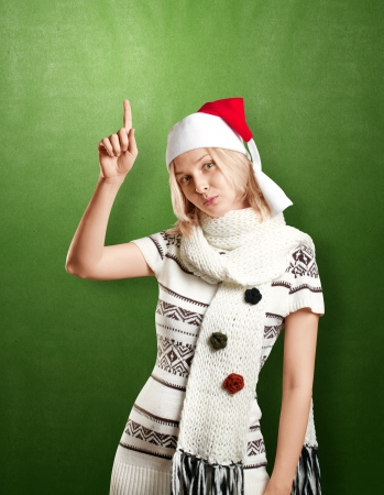 Woman with Santa's hat waiting for Christmas photo