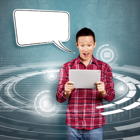 Asian man with speech bubble and touch pad in his hands got good news Stock Photo - 17237431