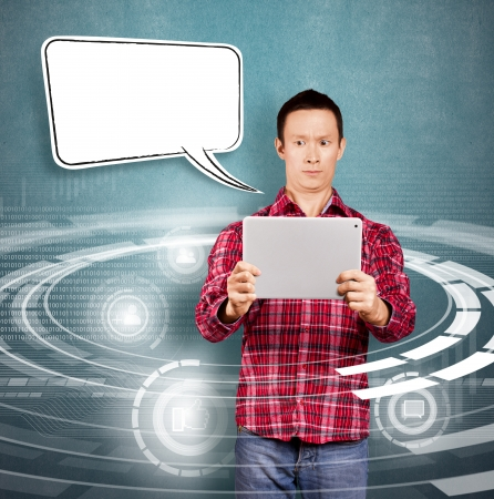 Asian man with speech bubble and touch pad in his hands embarrassed with news Stock Photo - 17237430
