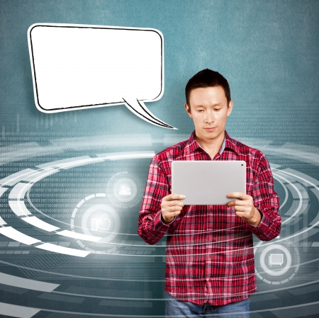 Asian man with speech bubble and touch pad in his hands embarrassed with news Stock Photo - 17237428