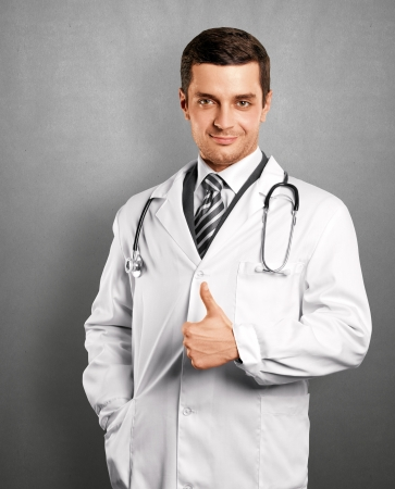 well done: Doctor man with stethoscope shows well done Stock Photo