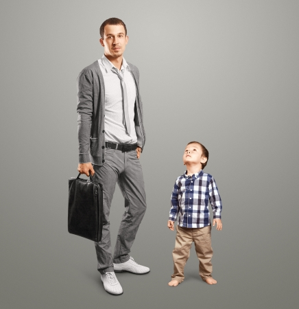 heir: Happy father business man with little baby son