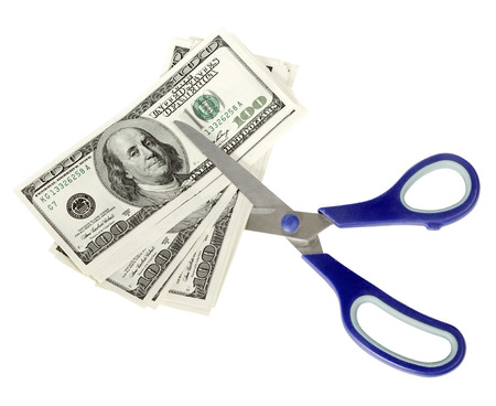 cutback: USA dollars with scissors, isolated on white background